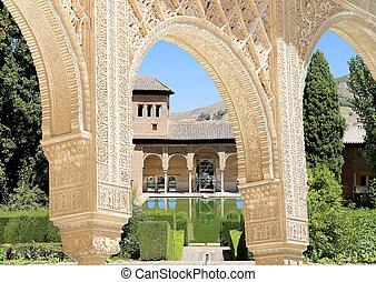 Arches in Islamic (Moorish) style and Alhambra, Granada,...