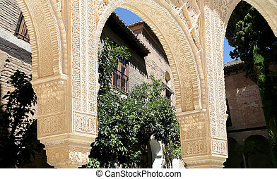 Arches in Islamic Moorish style and Alhambra, Granada, Spain...