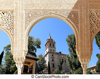 Arches in Islamic (Moorish) style and Alhambra, Granada,...