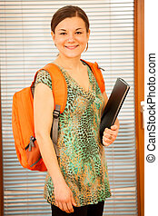 Adult woman representing lifelong learning Woman with school...
