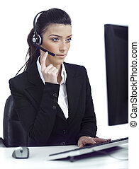 Busy woman seriously hearing the customer talk in headset