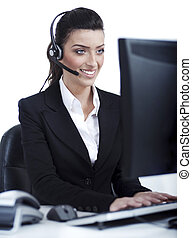 Woman wearing headset in computer room at her cabin