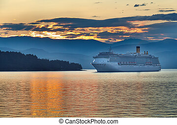 Sunrise in the greek archipelago with cruise ship...