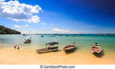Camera Moves to Vietnamese Tourist Boats at Beach up to...