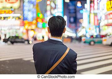Businessmnn in Shinjuku, Tokyo, Japan. - Solitary japanese...