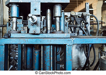 close-up of hydraulic blue, worn out machinery - close-up of...