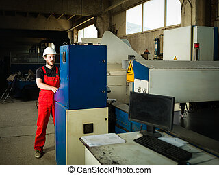 man operating control panel in industrial setting - view...