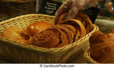Buying baked bread in a bakery window display