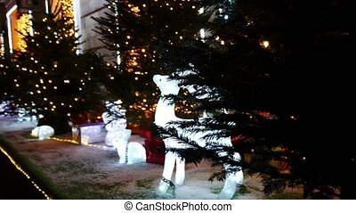 Christmas tree with deer made of light.  Christmas decoration or installation.