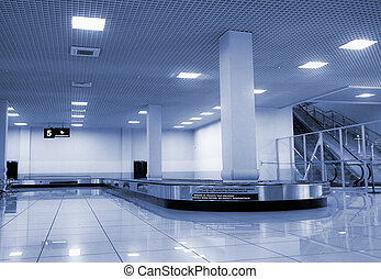 baggage claim area in airport photo