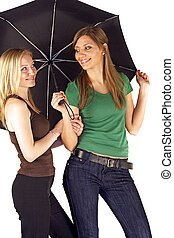 Sheltering - Two girlfriends sheltering under an um