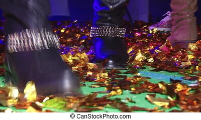 Beautiful dancing feet on gladness revelry party.