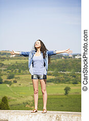 Freedom - Beautiful young woman feeling the summer breeze...