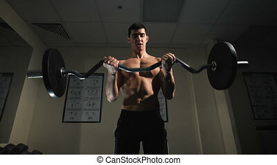 Young athlete trains with fitness equipment. Closeup