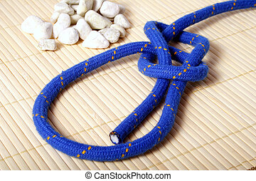 Bowline Knot - A fine knotted bowline knot lying next to a...