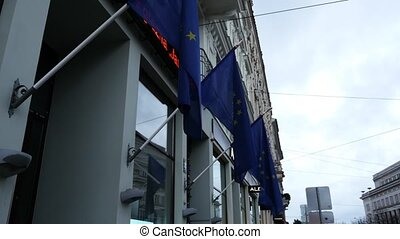 EU flags in front of builing with ticker