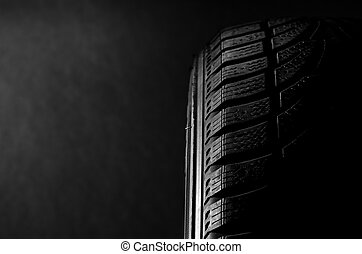 Tire  - Image of a black tire on black