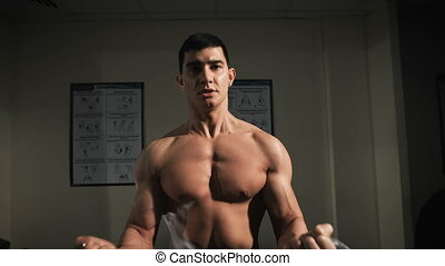 Muscular Man Doing Heavy Weight Exercise For Biceps. Closeup