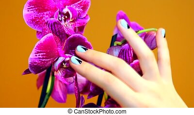 manicure on female hand with Orchid