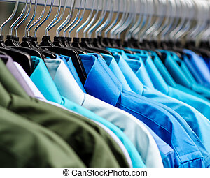 Collared shirts  - image of many collared shirts hanging