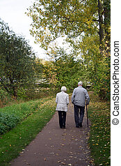 Taking A Walk - An elderly couple taking a walk in the woods...