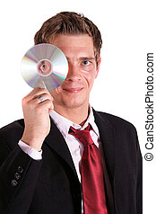 Data Integrity - A smarting businessman holding a cd or dvd....