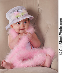 Boa Baby - An adorable baby girl sitting in a plush chair,...