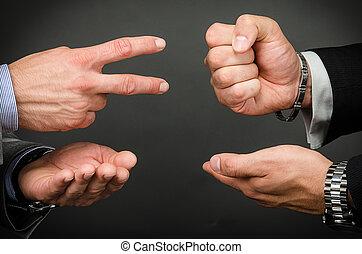 Rock paper scissor - Image of two men playing rock, paper,...