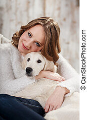 Pet's warm frienship - Young woman with her pet, golden...