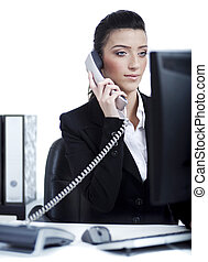 Young business woman making a phone call at office