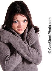 Freezing Young Woman - A handsome young woman freezing All...