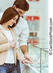 Couple choosing wedding ring - Happy beautiful young couple...