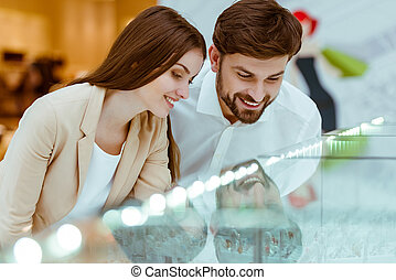 Couple choosing wedding ring - Happy beautiful young couple...