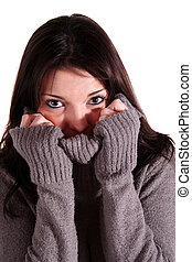 Chills - A handsome young woman freezing All isolated on...