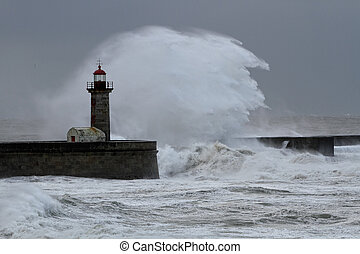 Bige wave over old lighthouse and granite pier, north of...