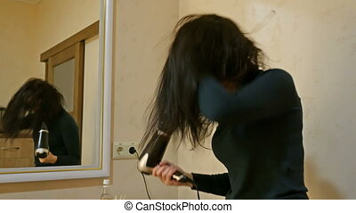 Pretty woman drying long hair in make-up room - Beautiful...
