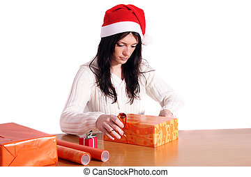 Wrapping Presents - A handsome young woman wrapping presents...