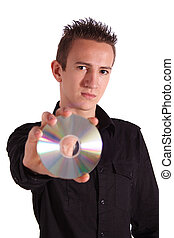 Data Privacy - A young handsome man holding a cd or dvd. All...