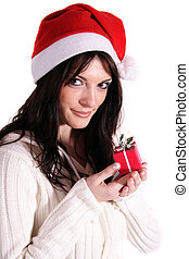 Kris Kindle - A handsome young woman holding a small red...