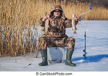 fisherman catch pike on winter fishing - catch pike on...