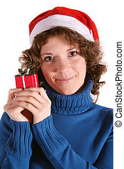 Kris Kindle - A handsomeyoung woman holding a small red...