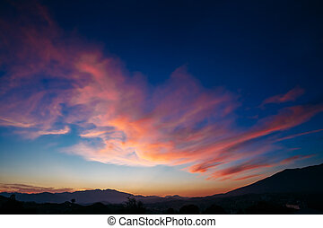 Colorful Sunset, Sunrise  over Mountains Background. Blue, Red,
