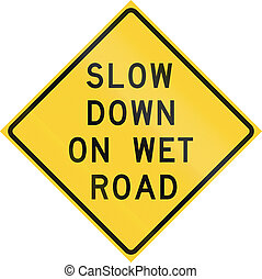 Road sign used in the US state of Texas - Slow down on wet...