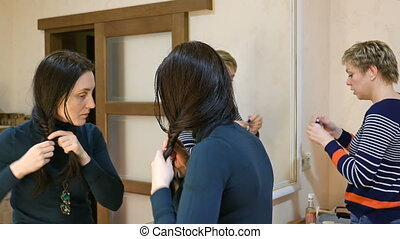 Two girl friends gossiping in dressing makeup room - Two...