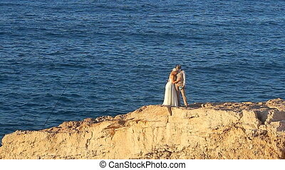 Wedding couple staying over beautiful landscape