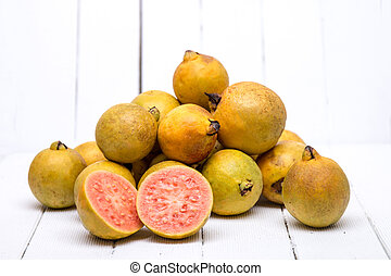 Fresh guava fruits on a white background. - Close up view of...