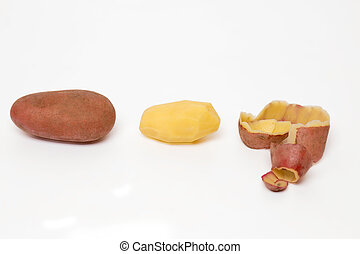 potato pealing process on a white background - Close up view...