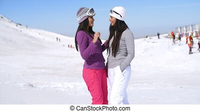 Two attractive women friends at a ski resort - Two...