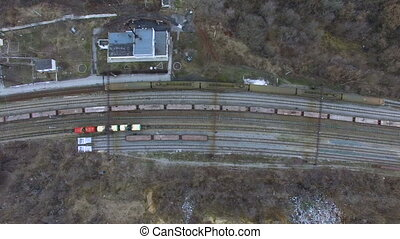 Flying over railway tracks - Flying over the road bridge in...