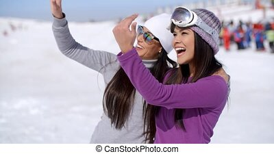 Laughing young woman on winter vacation
